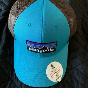 Teal and grey Patagonia trucker hat.